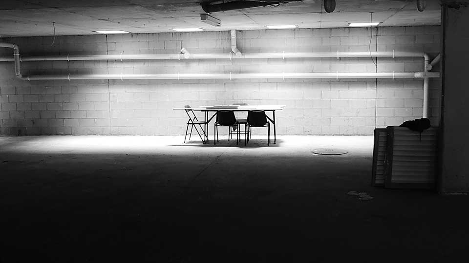 Unsplash black & white table and chairs on an empty stage