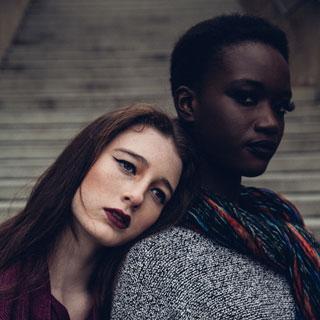 Two women together: one white, one black courtesy Shamim Nakhai at Unsplash