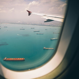 Jet wingtip viewed from inside the cabin courtesy Unsplash